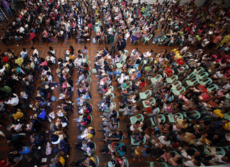 Mothers breastfeed their babies as they take part in a nationwide simultaneous breastfeeding activity in Marikina