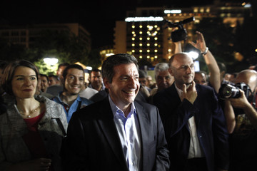 Re-elected Mayor of Athens Kaminis smiles at Syntagma square in Athens
