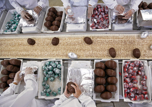 Employees pack Easter egg candy in preparation for the Easter holiday, at Top Cau factory in Sao Paulo
