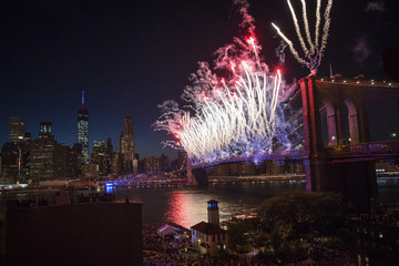 """Fireworks explode over Brooklyn Bridge and East River during """"Macy's Fourth of July Fireworks Spectacular"""" in Brooklyn borough of New York"""