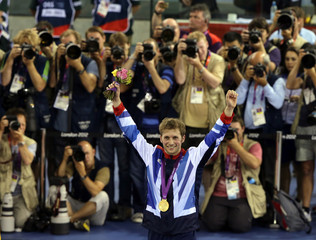 Britain's Jason Kenny stands with his gold medal during the victory ceremony after the track cycling men's sprint gold finals at the Velodrome during the London 2012 Olympic Games