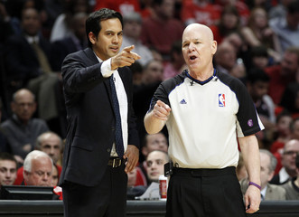 Heat head coach Spoelstra talks with official referee Crawford during Game 3 of their NBA Eastern Conference semi-finals basketball playoff series in Chicago