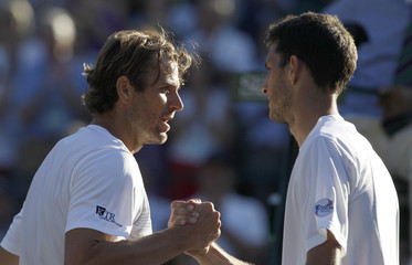 Mardy Fish of the U.S. shakes hands with James Ward of Britain after defeating him in their men's singles tennis match at the Wimbledon tennis championships in London