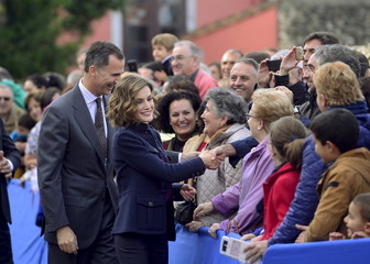 Spain's King Felipe and Queen Letizia greet members of the crowd during a visit to Colombres in Asturias