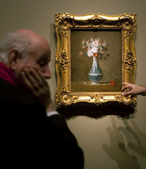 People examine A Vase of Flowers at an exhibition of French painter Chardin at the Prado in Madrid