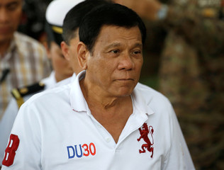 Philippine President Rodrigo Duterte arrives at Camp Tecson to talk to soldiers in San Miguel, Bulacan in northern Philippines
