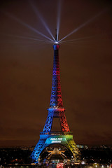 A picture shows the Eiffel Tower lit in the colours of the Olympic flag during the launch of the international campaign for the Paris bid to host the 2024 Olympic Games