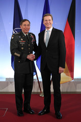 German Foreign Minister Westerwelle shakes hands with US Army General Petraeus at the foreign ministry in Berlin
