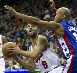 San Antonio Spurs' Parker looks to shoot around New Jersey Nets' Gaines in their NBA game in New Jersey