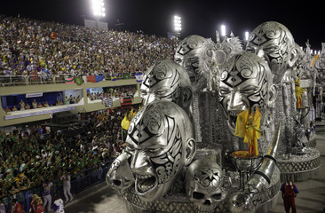 Revellers from the Uniao da Ilha samba school takes part in the parade on the second night of the annual Carnival parade in Rio de Janeiro's Sambadrome