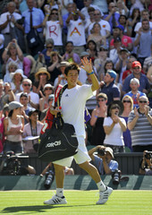 Japan's Kei Nishikori waves as he leaves the court after his match agains Spain's Rafael Nadal at the 2010 Wimbledon tennis championships in London