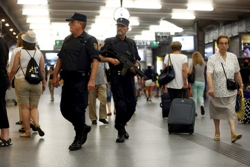 Police officers patrol at Atocha train station in Madrid