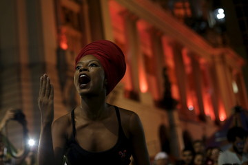 """A woman performs during a theatrical play at the """"Fest for Democracy"""" culture and political event in Rio de Janeiro"""