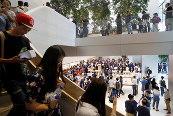 People visit the city-state's first Apple Store on its opening day at Orchard Road