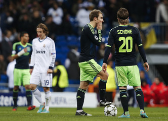 Ajax Amsterdam's Eriksen and Schone after Real Madrid's fourth goal during their Champions League Group D soccer match at the Santiago Bernabeu stadium in Madrid