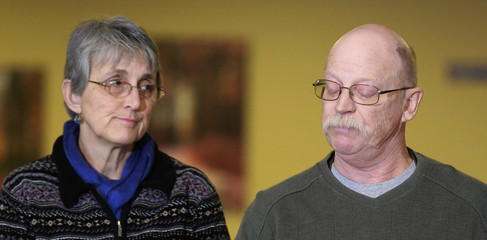 Paula and Ed Kassig, parents of U.S. aid worker Peter Kassig, pause while reading a statement while speaking to the press in Indianapolis