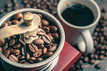 close up coffee bean in grinder and cup