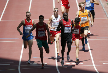 Rotich crosses the finish line first to win his heat in the men's 800 metres at the 15th IAAF World Championships in Beijing