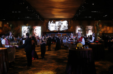 Waitstaff awaits guests at the Governors Ball following the 87th Academy Awards in Hollywood
