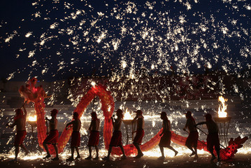 Chinese men perform a fire dragon dance at Happy Valley temple fair celebrating Chinese New Year in Beijing