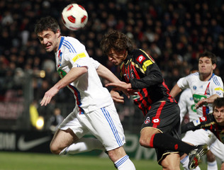 Olympique Lyon's Jeremy Toulalan challenges Renato Civelli of Nice during their French Cup soccer match at Le Ray stadium in Nice