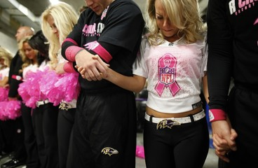 Baltimore Ravens cheerleaders including Jamie pray prior to a Ravens NFL football game in Baltimore