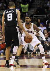 Cleveland Cavaliers' Irving defends San Antonio Spurs' Parker during their NBA basketball game in Cleveland