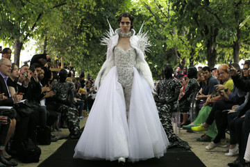 A model presents a creation by Bulgarian designers Livia Stoianova and Yassen Samouilov as part of their Haute Couture Fall/Winter 2014-2015 fashion show for fashion house On Aura Tout Vu in Paris
