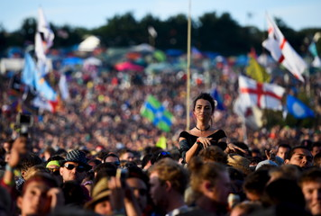 Revellers dance as The Libertines perform on the Pyramid stage at Worthy Farm in Somerset during the Glastonbury Festival
