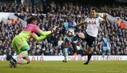 Tottenham's Son Heung-min in action with Wycombe Wanderers' Jamal Blackman