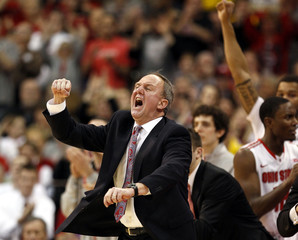 Ohio State head coach Thad Matta celebrates after defeating Michigan in their NCAA men's basketball game in Columbus