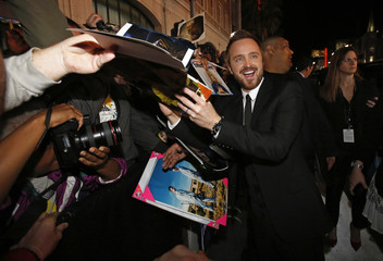 "Cast member Paul signs autographs at the premiere of ""Need for Speed"" at the TCL Chinese theatre in Hollywood"