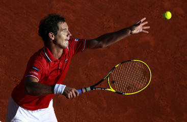 Gasquet of France serves to Istomin of Uzbekistan during the first round of the Monte Carlo Masters tennis tournament in Monaco