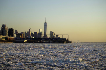 The One World Trade Center tower is pictured in the background as ice floes are viewed along the Hudson River in New York