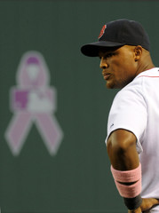 The symbol of a pink ribbon for breast cancer awareness is seen on Fenway Park's green monster in Boston