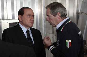 Italian PM Berlusconi speaks with Civil Protection Agency chief Bertolaso during a visit at the rubbish incinerator in Acerra