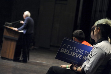 A supporter holds a sign as U.S. Democratic presidential candidate Bernie Sanders speaks at Iowa State University in Ames, Iowa