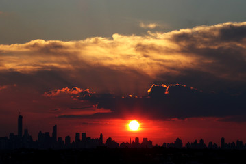 The sun sets over Manhattan before the opening ceremony at the 2014 U.S. Open tennis tournament in New York