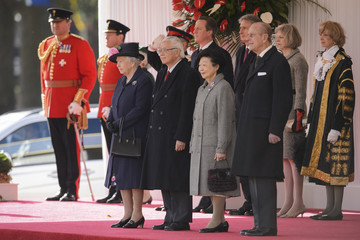 Britain's Queen Elizabeth and Prince Philip stand with Singapore's President Tony Tan and his wife Mary during the ceremonial welcome ceremony at Horse Guards Parade, in London
