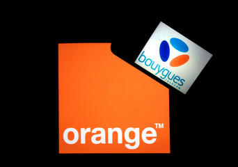 Company logos for Orange, on a tablet screen, and Bouygues Telecom, on a mobile phone screen, are seen in this illustration photo taken in Nice