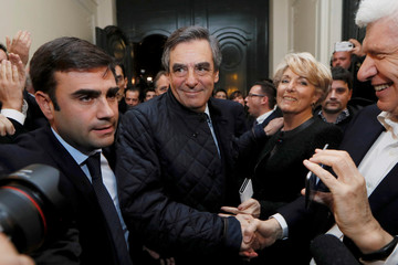 French politician Francois Fillon, member of the conservative Les Republicains political party, arrives inside his campaign headquarters after partial results in the first round of the French center-right presidential primary election in Paris