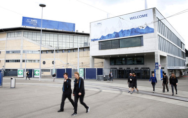 People walk in front of the Hallenstadion where the upcoming 65th FIFA Congress will take place in Zurich