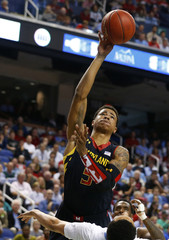 Maryland Terrapins' Faust shoots against the North Carolina Tar Heels during the first half of their ACC Championship college basketball game in Greensboro