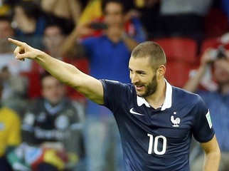 France's Benzema celebrates scoring his third goal against Honduras during their 2014 World Cup Group E soccer match at the Beira-Rio stadium in Porto Alegre