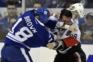 Maple Leafs forward Mike Brown fights Senators forward Zenon Konopka during their NHL hockey game in Toronto