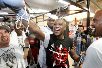 Floyd Mayweather Jr. of the U.S. puts his glove toward a video camera during a media workout at his gym in Las Vegas