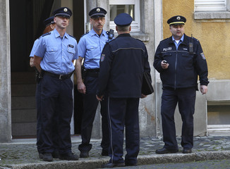 German policemen stand in the street where early in the morning a man shot a security officer with an air rifle, before the Eucharist celebration by pope Benedict XVI on Cathedral Square in Erfurt