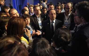 French President Francois Hollande speaks with journalists after a news conference at the NATO Summit in Chicago