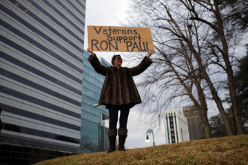 A woman holds a sign in support of Republican presidential candidate Ron Paul (R-TX) in Columbia, South Carolina