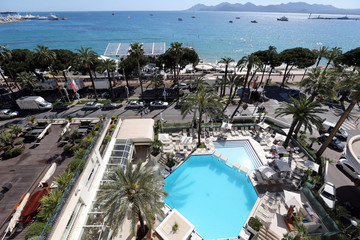 A general view shows the swimming pool of Grand Hyatt Cannes Hotel Martinez, the Croisette and the bay of Cannes before the start of the 66th Cannes film festival